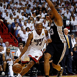 Jun 18, 2013; Miami, FL, USA; Miami Heat shooting guard Ray Allen (34) drives against San Antonio Spurs center Boris Diaw (33) during the second quarter of game six in the 2013 NBA Finals at American Airlines Arena.  Mandatory Credit: Derick E. Hingle-USA TODAY Sports
