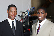 LOS ANGELES - JULY 19:  Hall of Fame running back Marcus Allen (left) of the Los Angeles Raiders (and Kansas City Chiefs) with linebacker Jonathan Vilma of the New York Jets during a break in the filming of the NFL's 2005 Super Bowl XL television ad campaign in Los Angeles, California on July 19, 2005. ©Paul Anthony Spinelli *** Local Caption *** Marcus Allen, Jonathan Vilma
