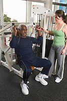 Personal Trainer Working with Senior Man