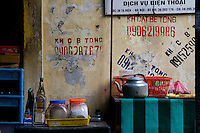 Everyday items of a small outdoor restaurant in Hanoi's old quarter.