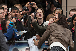 © licensed to London News Pictures. London, UK 10/06/2012. Russell Brand posing to a picture with one of his fans at European premiere of Rock of Ages today in Leicester Square (10/06/12). Photo credit: Tolga Akmen/LNP