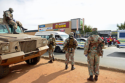 South Africa – Johannesburg – Military personnel are brought in to assist restore order at Shoprite Devland after a staff member tested positive to covid-19 and the rest of  the team went on protest action to be tested too.  Picture: Timothy Bernard/African News Agency(ANA)