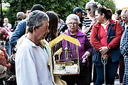 Mexicans wait with their pets for the annual blessing of the animals on the feast day of San Antonio Abad at Oratorio de San Felipe Neri church in the historic center of San Miguel de Allende, Guanajuato, Mexico.