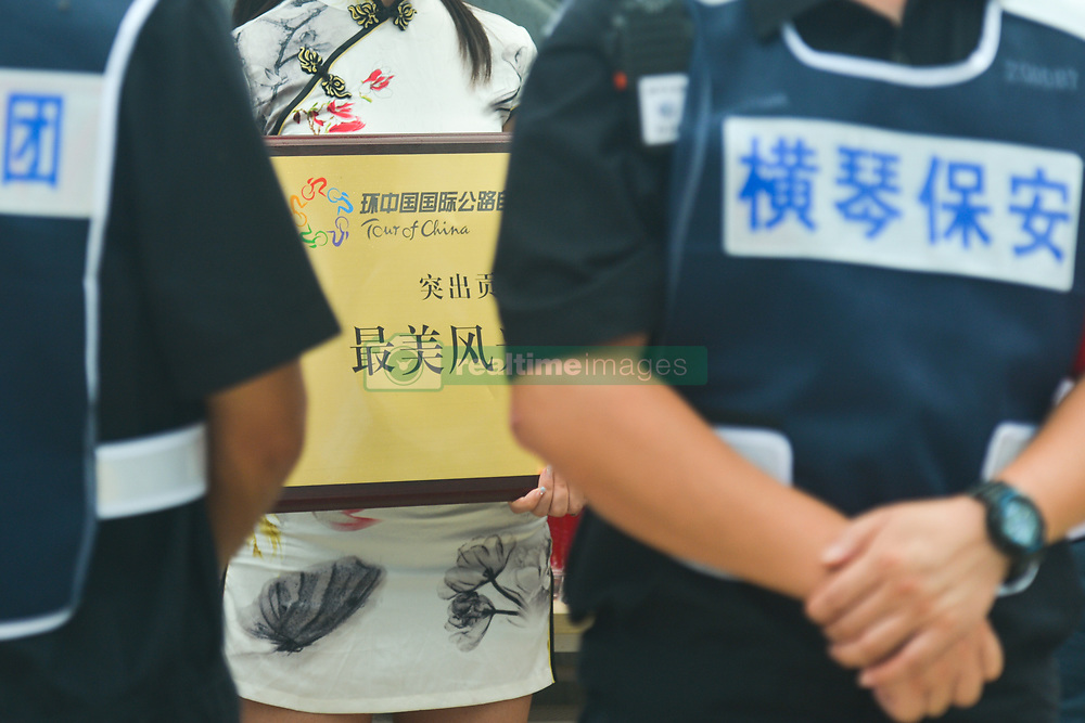 September 24, 2017 - Zhuhai, Guangdong, China - The tour hostess carries an Award ahead of the Awards Ceremony of the 2017 Tour of China 2. .On Sunday, 24 September 2017, in Hengqin district, Zhuhai City, Guangdong Province, China. (Credit Image: © Artur Widak/NurPhoto via ZUMA Press)