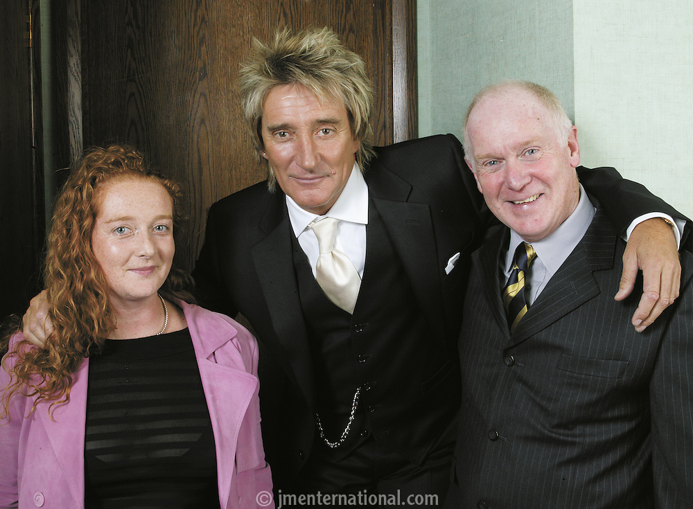 Rob Dickins CBE receives the Music Industry Trust&rsquo;s Award at the Grosvenor Hotel London.<br /> Presented to him by Rod Stewart.<br /> <br /> EMMA POWELL Marketing Manager BMG UK, Rod Stewart and Tony Powell.<br /> <br /> Tony Powell<br /> I've known Rod since the 60's and worked with him at Phonogram at the start of his solo career at the beginning of the 70's as artist relations and then as his marketing manager.I went to work for him and set up Riva records in the late 70's(the Brit Ekland period!!!!)but went back to Phonogram.I have kept in touch with him on and off and my daughter Emma was his marketing  manager at Warner's under Rob Dickens and now looks after him at BMG.