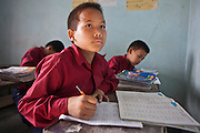 A young Nepalese boy looks at the teaching board in during a lesson in a classroom at the GoodWeave centre in Attarkhen, Kathmandu, Nepal.  The children's parents are carpet factory workers, and the children have been supported into education by GoodWeave, a charity that works towards getting children out of factories and into education.  Previously these children would have been left unattended in the factory while their parents worked as their low salary could not cover childcare costs. GoodWeave were recipients of the Stars Foundation's Impact Award.