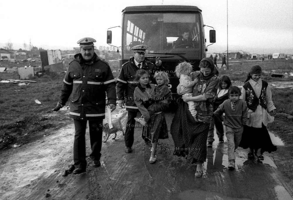 Rome   29 December 1999.Dismantling the camp area where Romani refugees from Bosnia live in. The people are moved in a equipped camp provided by the local government.