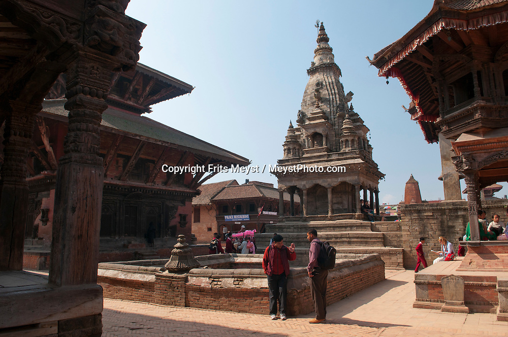 KATHMANDU VALLEY FILE PHOTO: UNESCO sites and other historical buildings from before the Nepal 2015 Earthquake. According to UNESCO's preliminary assessment on the ground, the monuments and sites within the Kathmandu Valley World Heritage property, as well as several other cultural and natural heritage sites located in the area, have been heavily affected. In particular, Durbar Squares of Patan, Hanuman Dhoka (Kathmandu) and Bhaktapur are almost fully destroyed.  <br /> <br />   Bhaktapur Durbar Square, Central Valley, Nepal, November 2012.  Located about 20 km east of Kathmandu in the Kathmandu Valley, Bhaktapur is one of the 3 royal cities in the Kathmandu Valley. The others are Kathmandu, the capital of Nepal, and Patan. Bhaktapur is filled with monuments, most terra-cotta with carved wood columns, palaces and temples with elaborate carvings, gilded roofs, open courtyards. The city is dotted with pagodas and religious shrines. Lying along the ancient trade route between India and Tibet, Bhaktapur is surrounded by mountains and provides a magnificent view of the Himalayas. Photo by Frits Meyst / MeystPhoto.com