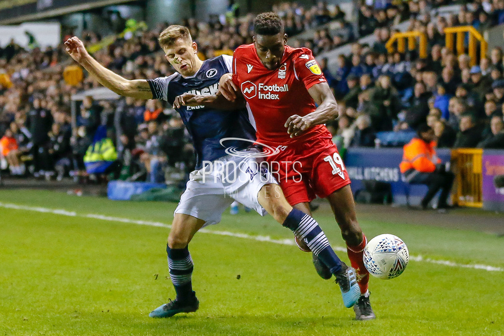 Millwall midfielder Jayson Molumby (16) battles for possession with Nottingham Forest forward Sammy Ameobi (19) during the EFL Sky Bet Championship match between Millwall and Nottingham Forest at The Den, London, England on 6 December 2019.