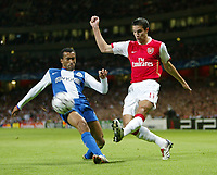 Photo: Chris Ratcliffe.<br /> Arsenal v FC Porto. UEFA Champions League, Group G. 26/09/2006.<br /> Robin Van Persie of Arsenal clashes with Bruno Alves of Porto.