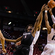 09 March 2018: San Diego State men's basketball takes on Nevada in the quarterfinal round of the Mountain West Conference Tournament. San Diego State Aztecs forward Jalen McDaniels (5) battles Nevada Wolf Pack guard Hallice Cooke (13) for a rebound in the first half. The Aztecs cruise past the Wolfpack 90-73 to move on to the Championship game tomorrow afternoon at 3pm.<br /> More game action at www.sdsuaztecphotos.com