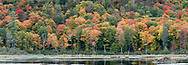 Fall foliage color at the Beaver Pond at Gatineau Park in Gatineau, Quebec, Canada.  Photographed from the Gatineau Parkway in during Fall Rhapsody at Gatineau Park.