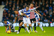 Rangers Midfielder Luke Freeman & Brentford's Midfielder Nico Yennaris during the EFL Sky Bet Championship match between Queens Park Rangers and Brentford at the Loftus Road Stadium, London, England on 10 November 2018.