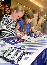 "Cadburys Spots vs Stripes Challenge Race Season Meadowhall Sheffiel.competeing for ""Fastest Doodler"" Katie Hawkridge and Megan King both aged 10 from Barnsley.2 April 2011.Images © Paul David Drabble"