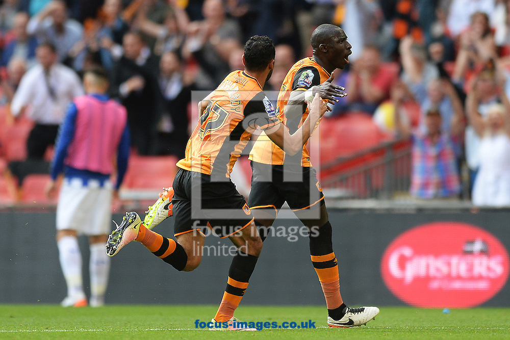 Mohamed Diame of Hull City (r) celebrates scoring his sides first goal to make the scoreline 1-0 during the Sky Bet Championship Play-off Final between Hull City and Sheffield Wednesday at KC Stadium, Hull<br /> Picture by Richard Blaxall/Focus Images Ltd +44 7853 364624<br /> 28/05/2016