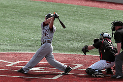 26 April 2014:  Will Farmer bats in front of Mike Hollenbeck and umpire Bret Bruington during an NCAA Division 1 Missouri Valley Conference (MVC) Baseball game between the Southern Illinois Salukis and the Illinois State Redbirds in Duffy Bass Field, Normal IL