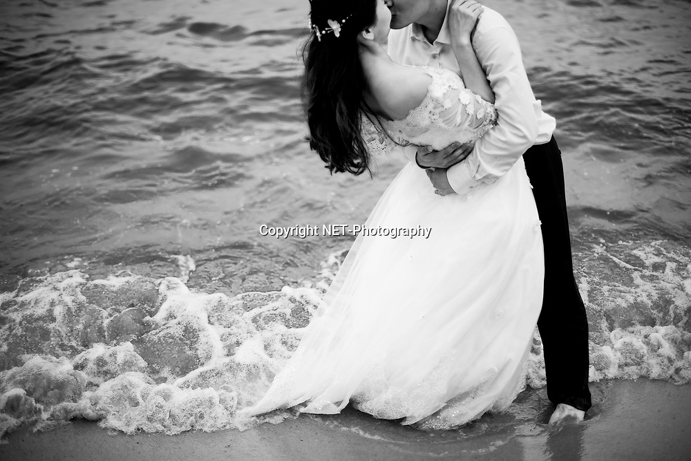 Hua Hin Thailand - Jojo &amp; Richard's pre-wedding (prenuptial, engagement session, couple, honeymoon, post-wedding) on a beach near Novotel Hotel in Hua Hin, Thailand. <br /> <br /> Photo by NET-Photography.<br /> info@net-photography.com<br /> <br /> View this album on our website at http://thailand-wedding-photographer.com/hua-hin-beach-khao-sam-roi-yot-national-park-pre-wedding-photography/?utm_source=photoshelter&amp;utm_medium=link&amp;utm_campaign=photoshelter_photo<br /> <br /> NET-Photography | Hua Hin Wedding Photographer<br /> Thailand Professional Wedding Photography Service