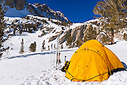 Yellow dome tent in winter, Inyo National Forest, Sierra Nevada Mountains, California