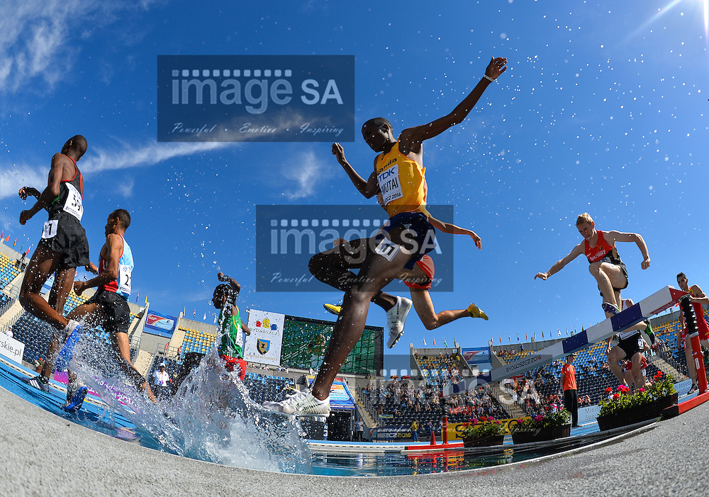 BYDGOSZCZ, POLAND - JULY 21: Albert Chemutai of Uganda at the water jump in the mens 3000m steeplechase during day 3 of the IAAF World Junior Championships at Zawisza Stadium on July 21, 2016 in Bydgoszcz, Poland. (Photo by Roger Sedres/Gallo Images)