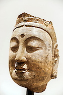 Roslyn, New York, USA. January 2, 2015. Head of a Bodhisattva (probably from Kiangtangshan) Northern Qi Dynasty (550-577), limestone with traces of pigment, is displayed at the Nassau County Museum of Art China Now and Then Exhibit on Long Island. Head of a Bodhisattva, Sandstone, Northern Qi (550-577), 13 3/8 x 7 1/4 x 7 3/4 inches, Art Properties, Avery Architectural & Fine Arts Library, Columbia University in the City of New York, Sackler Collections