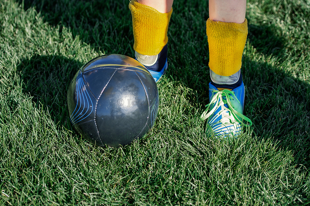 Youth soccer player with ball.
