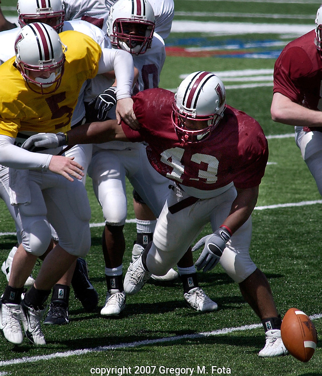"FOOTBALL FUMBLE--EASTON,PA--3S_FBCLAFAYETTE--Nigel Bryant , #26, a junior DB from Dade City, FL, carries the ball for Lafayette's Maroon (defense) team in the ""Maroon and White"" Spring Football Scrimmage Game at Lafayette College's Fisher Field on April 21, 2007.(Gregory M. Fota/Special to TMC) 04212007"