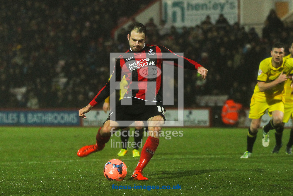 Picture by Tom Smith/Focus Images Ltd 07545141164<br /> 14/01/2014<br /> Brett Pitman of Bournemouth scores his sides fourth goal from the penalty spot during the The FA Cup match at the Goldsands Stadium, Bournemouth.
