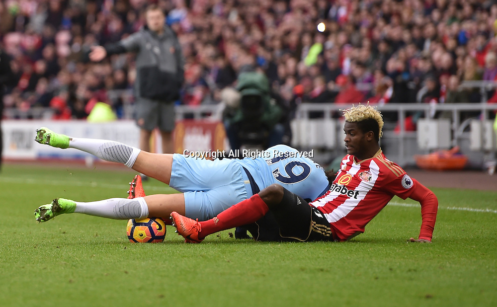 March 5th 2017, Stadium of Light, Sunderland, England; EPL Premier league football, Sunderland FC versus Manchester City; Didier Ndong of Sunderland tackles Leroy Sane of Manchester City