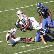 UofL linebacker Keith Brown missed picking up a UK fumble which was recovered by UK center Jon Toth late, right, in the fourth quarter as the University of Kentucky plays the University of Louisville at Commonwealth Stadium in Lexington, Ky. Saturday Sept. 14, 2013. Louisville beat Kentucky 27-13. Photo by David Stephenson