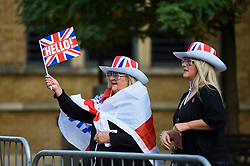 © Licensed to London News Pictures. 12/10/2018. WINDSOR, UK.  Crowds start to gather in Windsor for the royal wedding of Princess Eugenie and Jack Brooksbank.  Princess Eugenie, 28, the younger daughter of the queen's third child Prince Andrew and his ex-wife Sarah Ferguson, the Duchess of York, will marry Jack Brooksbank, a 32-year-old drinks executive, in Windsor Castle before taking part in a short carriage procession through Windsor town.  This is the second royal wedding in Windsor in 2018, Prince Harry married Meghan Markle in May.  Photo credit: Stephen Chung/LNP