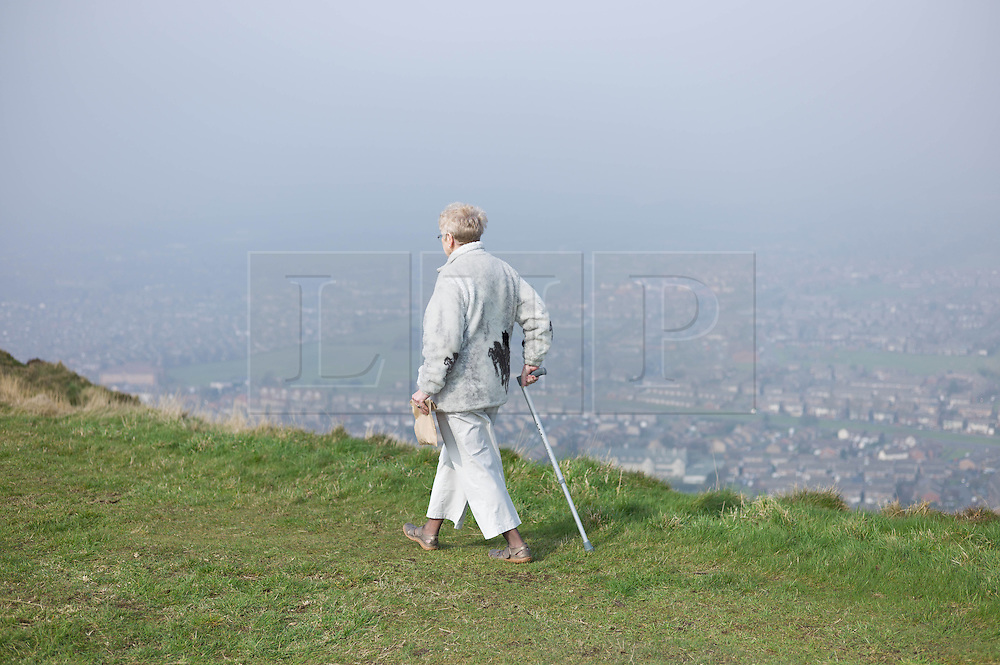 © Licensed to London News Pictures. 29/03/2014<br /> <br /> Eston Hills, Teesside, United Kingdom<br /> <br /> A woman walks along the top of Eston Nab on Teesside. A community group called the Friends of Eston Hills have recently raised £15000 in just seven weeks to buy the land and return it to public ownership. Today they held a celebration on top of the Nab which is the rocky summit of the Eston Hills to mark the occasion.<br /> <br /> The area will now be returned to public ownership for the first time in hundreds of years and there are plans to raise more funds to create a heritage trail, clean the site up and create a memorial to 375 miners who died when there was an iron mine on the site.<br /> <br /> <br /> Photo credit : Ian Forsyth/LNP