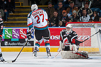 KELOWNA, CANADA - JANUARY 18: Calvin Thurkauf #27 of the Kelowna Rockets gets hit in the calf by a shot on the net of Brody Willms #35 of the Moose Jaw Warriors on January 18, 2017 at Prospera Place in Kelowna, British Columbia, Canada.  (Photo by Marissa Baecker/Shoot the Breeze)  *** Local Caption ***