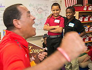 University of Houston basketball coach Kelvin Sampson reads to students during the Read for the NCAA Final Four kick-off at Blackshear Elementary School, September 24, 2015.