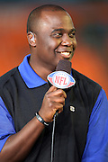 NFL Network football analyst Marshall Faulk talks football during the American Football Conference AFC All-Stars game against the National Football Conference NFC All-Stars in the 2010 NFL Pro Bowl, January 31, 2010 in Miami, Florida.  The AFC won the game 41-34. ©Paul Anthony Spinelli