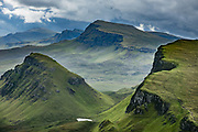From atop the Quiraing, look south to Bioda Buidhe mountain and Trotternish Ridge, on the Isle of Skye, Scotland, United Kingdom, Europe. We hiked a muddy loop on the Quiraing, 4.5 miles with 1200 feet gain. The Trotternish Ridge escarpment was formed by a great series of landslips, of which the Quiraing portion is still moving, causing the road at its base, near Flodigarry, to require repairs each year.