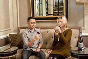 A young couple wine tasting at Chalk Hill Vineyard Estates in Healdsburg, California.