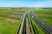 Nederland, Gelderland, Betuwe, 24-10-2013; Betuweroute, ter hoogte van Echteld. De goederenspoorlijn loopt parallel aan autosnelweg A15. De goederentrein is onderweg naar de haven van Rotterdam. Boomkwekerijen links in beeld, daarachter de Linge..<br /> Betuweroute, railway from Rotterdam to Germany, near Echteld. The freight railway runs parallel to highway A15. The freight is on its way to the port of Rotterdam.<br /> luchtfoto (toeslag op standaard tarieven);<br /> aerial photo (additional fee required);<br /> copyright foto/photo Siebe Swart.