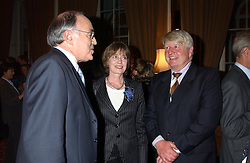 Left to right, MICHAEL HOWARD and MR & MRS STANLEY JOHNSON at a party to celebrate the publication o'Seventy Two Virgins' by Boris Johnson held at The Travellers Club, 106 Pall Mall, London on 14th September 2004.<br />