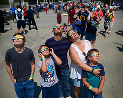 From left, Trevor, Evan, Todd, Cynthia and Ryan Striegel of Fort Mill, S.C. gaze at the solar eclipse from the rooftop of the Discovery Place parking deck on Monday, Aug. 21, 2017 in Charlotte, N.C. Photo by Jeff Siner/Charlotte Observer/TNS/ABACAPRESS.COM