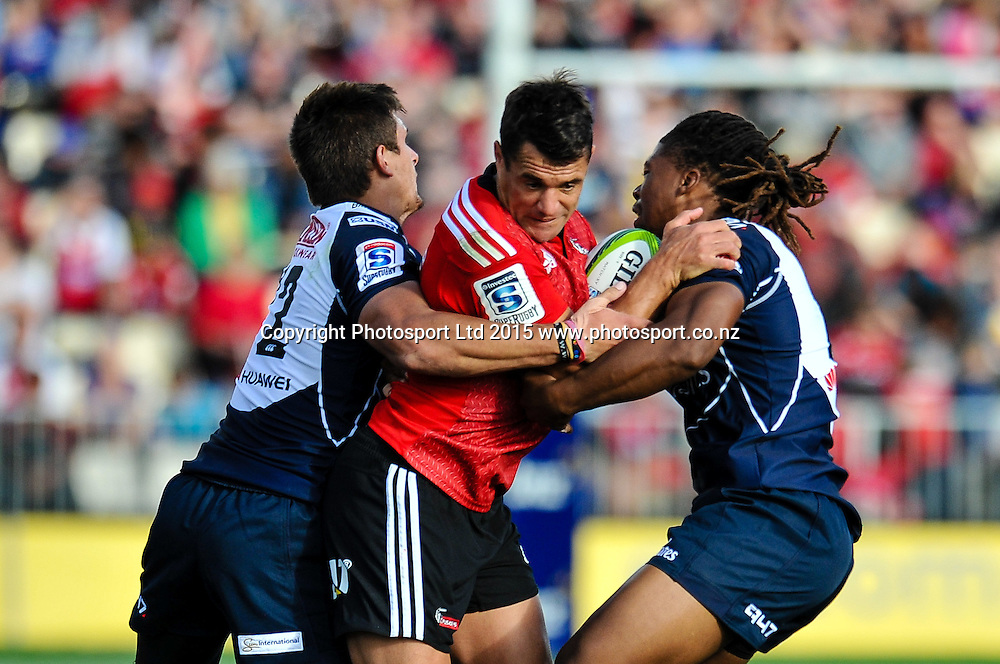 Dan Carter of the Crusaders is tackled by Howard Mnisi  and Harold Vorster of the Lions during the Super Rugby match: Crusaders v Lions at AMI Stadium, Christchurch, New Zealand, 14 March 2015. Copyright Photo: John Davidson / www.Photosport.co.nz