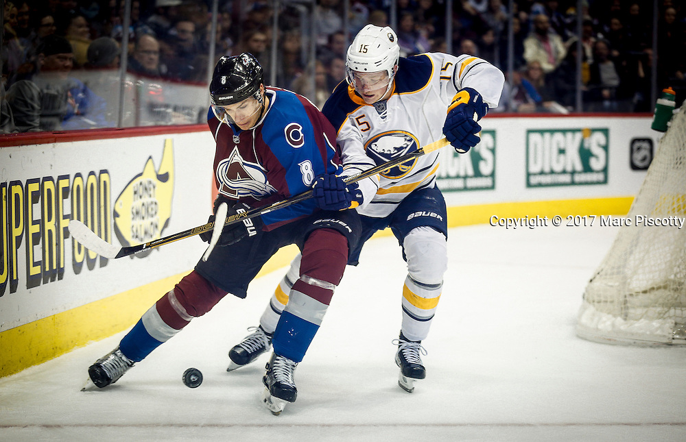 SHOT 2/25/17 10:33:14 PM - The Buffalo Sabres' Jack Eichel #15 battles the Colorado Avalanche's Joe Colborne #8 for a loose puck behind the net during their NHL regular season game at the Pepsi Center in Denver, Co. The Avalanche won the game 5-3. (Photo by Marc Piscotty / © 2017)