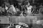 A shopper looks through limited supplies at a used goods store in Havana.