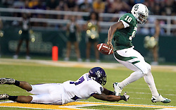 Baylor quarterback Robert Griffin III (10) steps out of the hands of Stephen F. Austin linebacker Justin Isadore (7) during an NCAA college football game, Saturday, Sept. 17, 2011, in Waco, Texas. Baylor won 48-0.