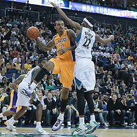 04 October 2010: Los Angeles Lakers forward Matt Barnes looks to pass the ball over Minnesota Timberwolves guard Corey Brewer during the Minnesota Timberwolves 111-92 victory over the Los Angeles Lakers, during 2010 NBA Europe Live, at the O2 Arena in London, England.