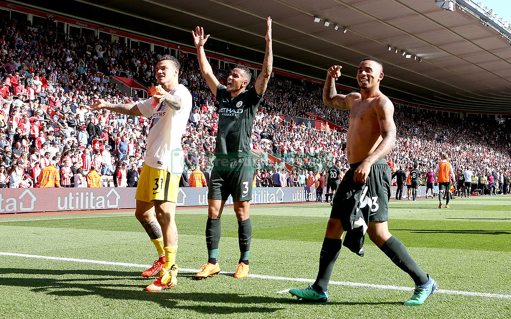Manchester City's Gabriel Jesus (right) celebrates scoring his side's first goal of the game with team-mates Manchester City goalkeeper Ederson (left) and Manchester City's Danilo (centre) during the Premier League match at St Mary's Stadium, Southampton.