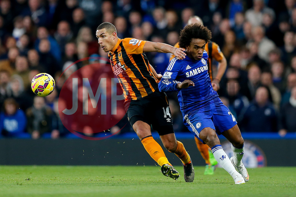 Jake Livermore of Hull City is challenged by Willian of Chelsea - Photo mandatory by-line: Rogan Thomson/JMP - 07966 386802 - 13/12/2014 - SPORT - FOOTBALL - London, England - Stamford Bridge - Chelsea v Hull City - Barclays Premier League.