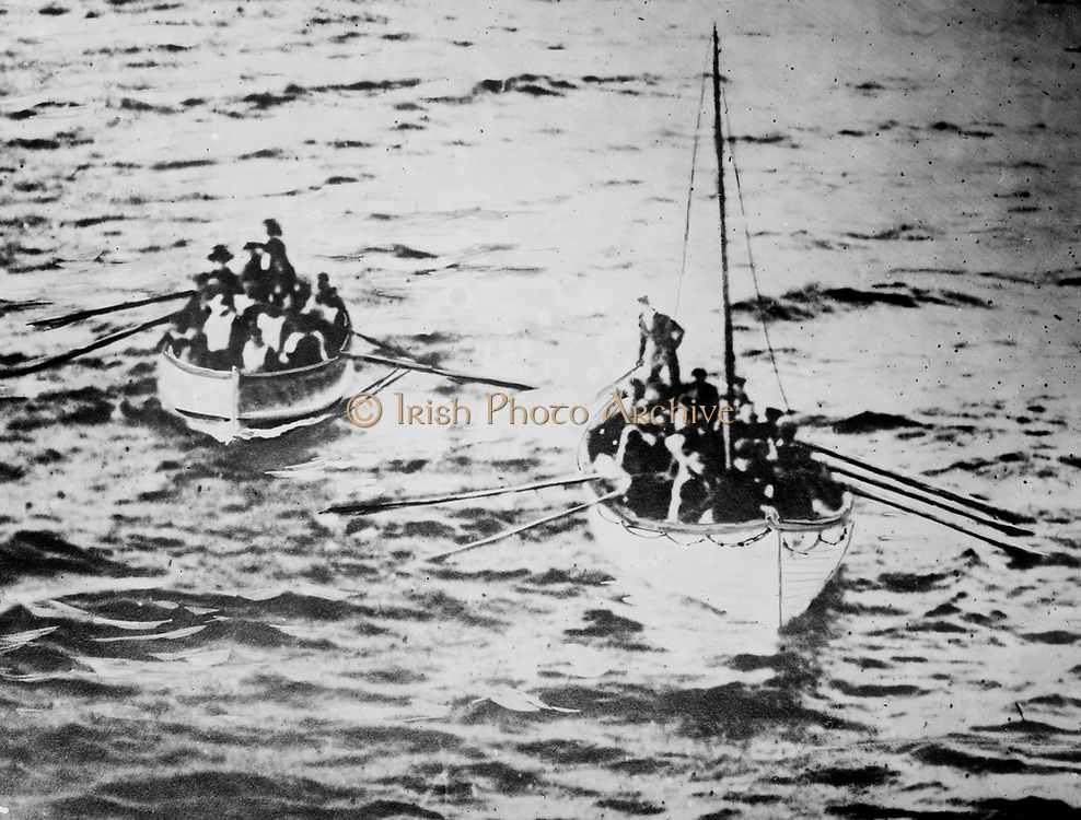 Loss of White Star Line's Olympic-class RMS Titanic which struck an iceberg on 12 April 1912 on her maiden voyage from Southampton to New York. Titanic's lifeboats on their way to the Carpathia. More than 1,500 lives lost. Disaster