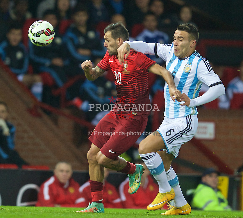 MANCHESTER, ENGLAND - Tuesday, November 18, 2014: Argentina's Nicolas Otamendi and Portugal's Danny during the International Friendly match at Old Trafford. (Pic by David Rawcliffe/Propaganda)