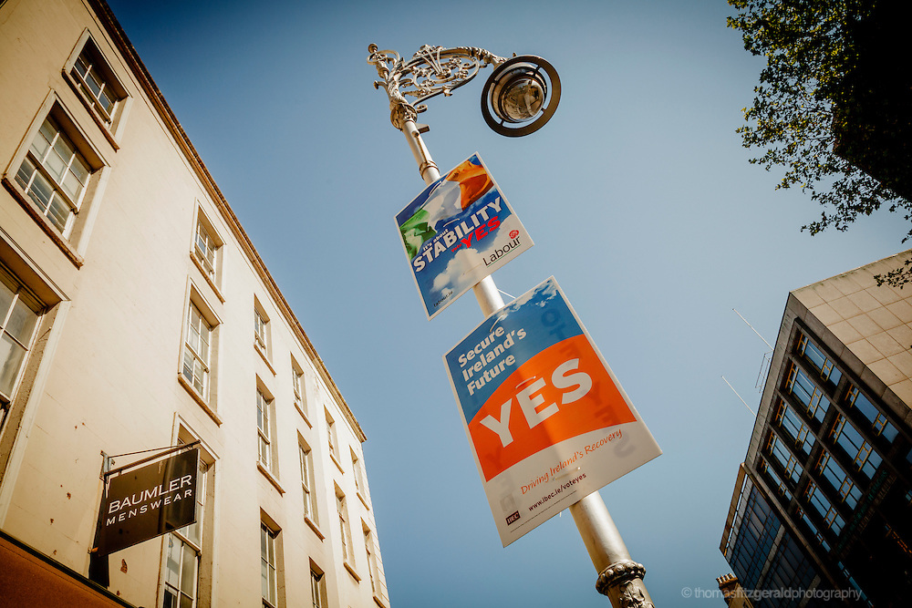 A pair of Yes posters for the upcoming fiscal treaty referendum on a pole as seen on Dublin's Dawson Street