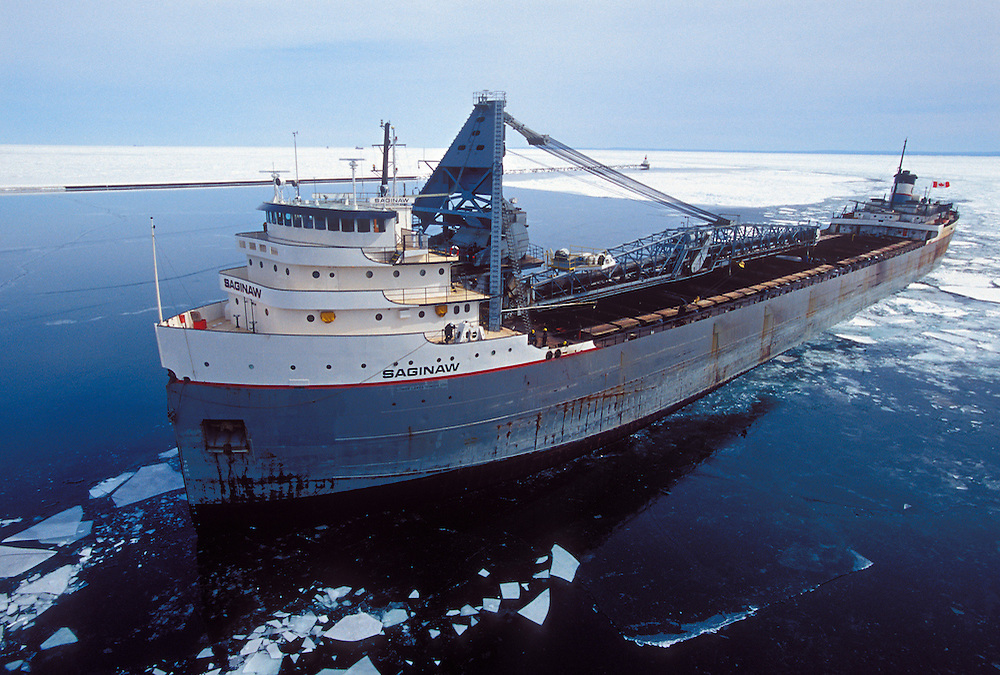 The freighter Saginaw enters the upper harbor of Marquette, Michigan through chuncks of ice after being freed from the ice by an ice breaker.